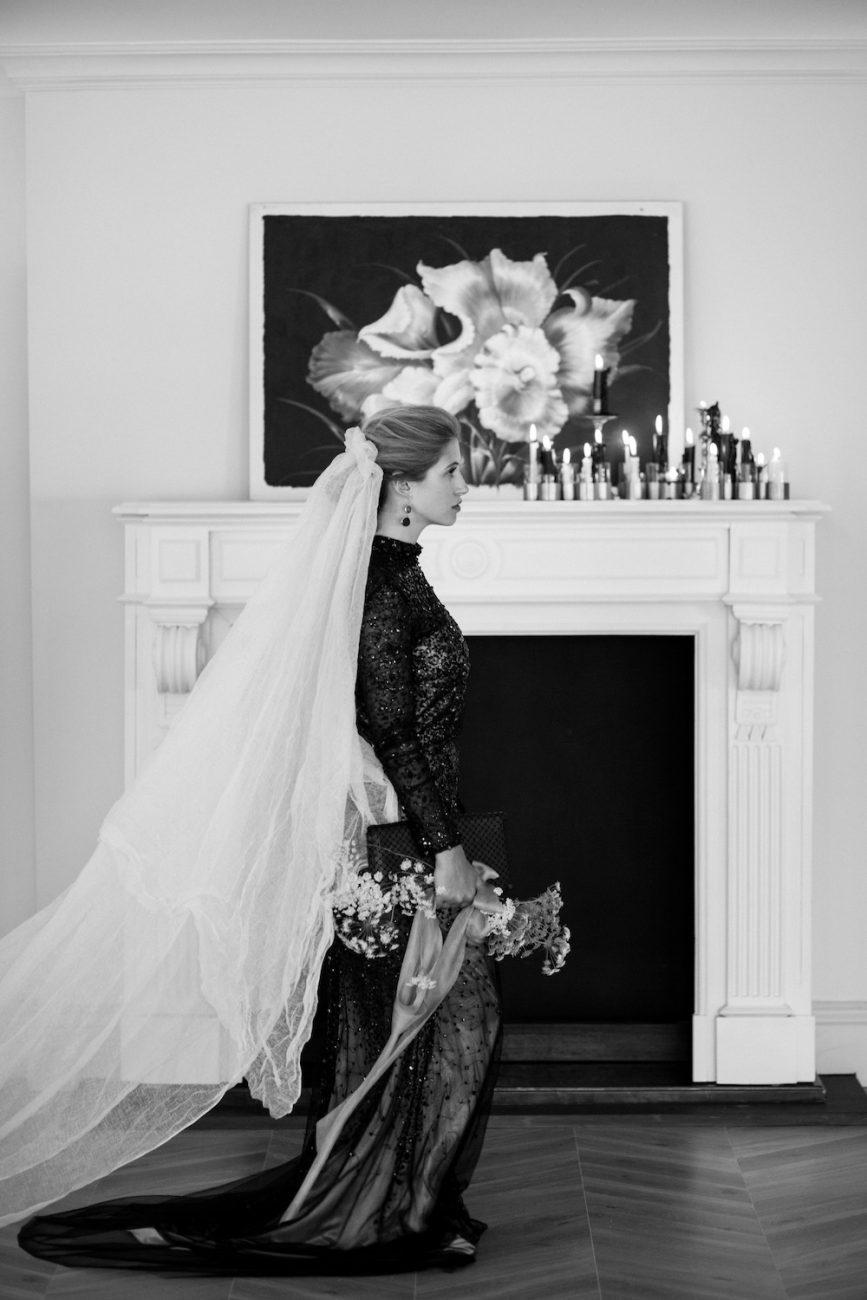 Fine Art Black Tie Wedding Inspiration Shoot bride walking past fireplace