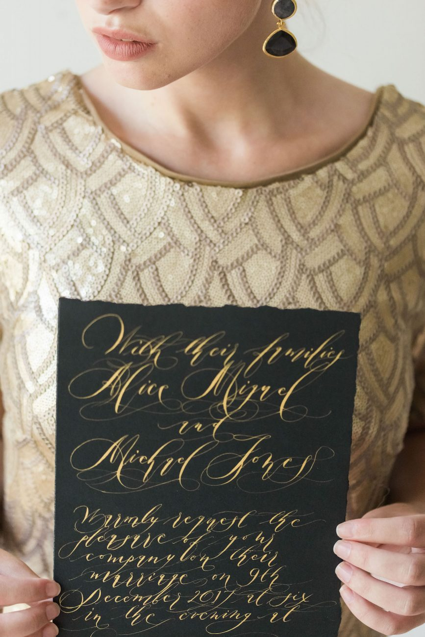 Fine Art Black Tie Wedding Inspiration Shoot bride with black card and gold calligraphy