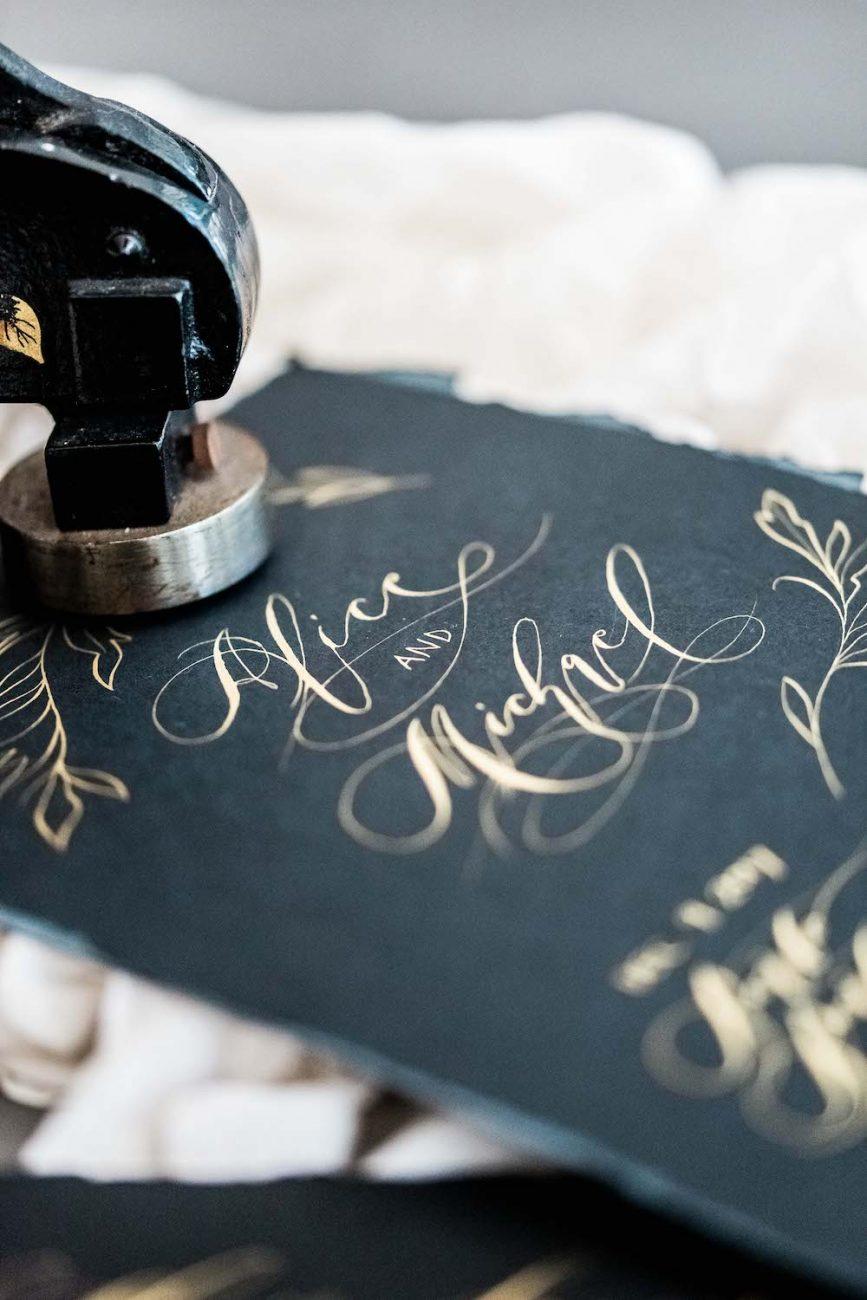 Fine Art Black Tie Wedding Inspiration Shoot calligraphy black invitation monogram card