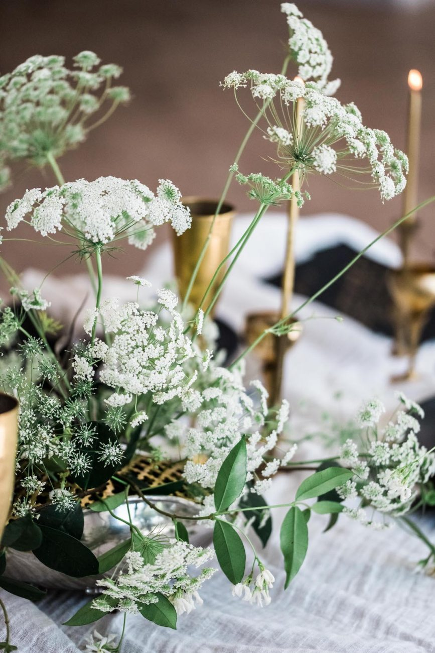 Fine Art Black Tie Wedding Inspiration Shoot green foliage with white flowers