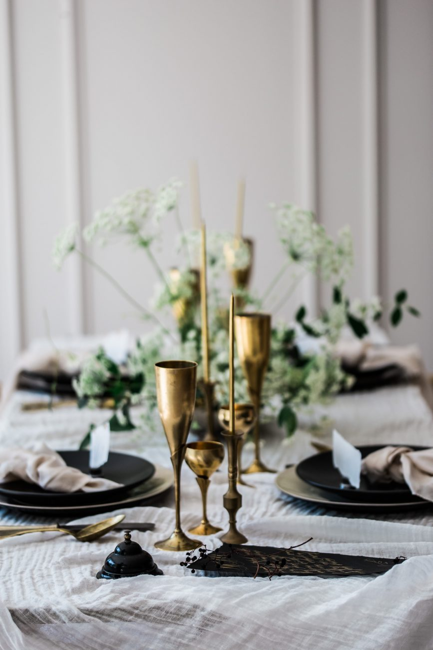 Fine Art Black Tie Wedding Inspiration Shoot table setting with gold glasses and menus