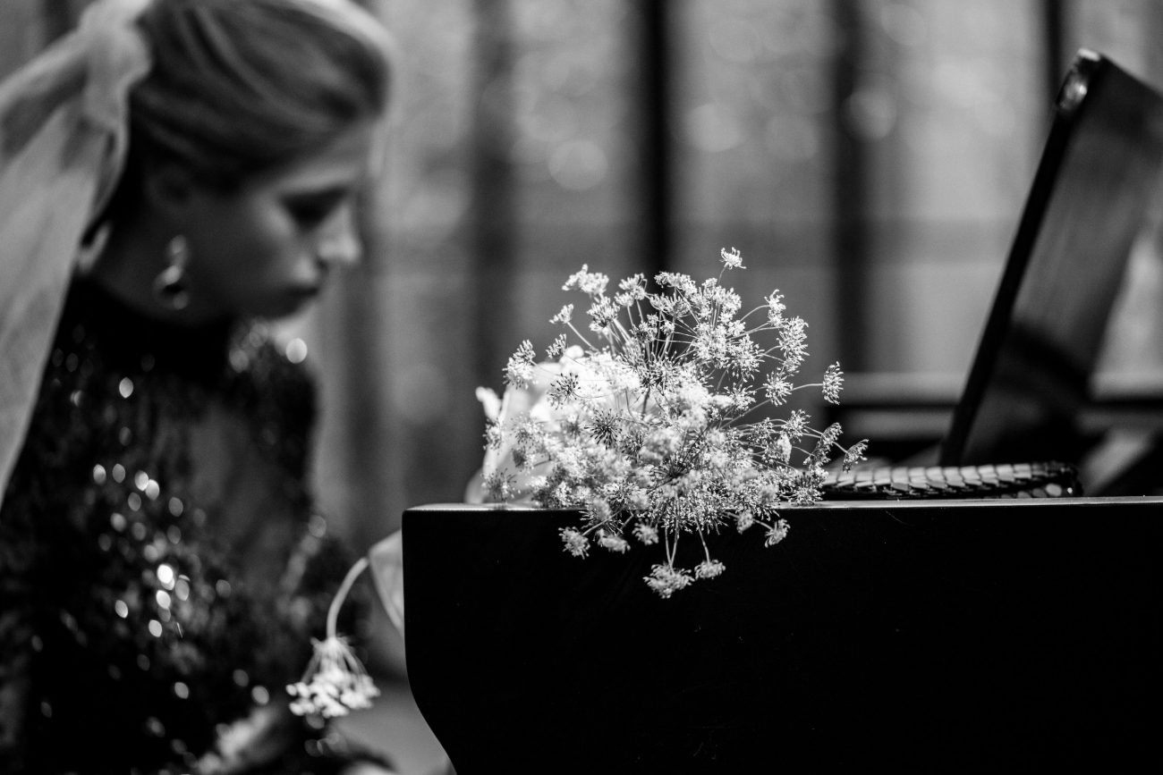 Fine Art Black Tie Wedding Inspiration Shoot with white flowers on piano