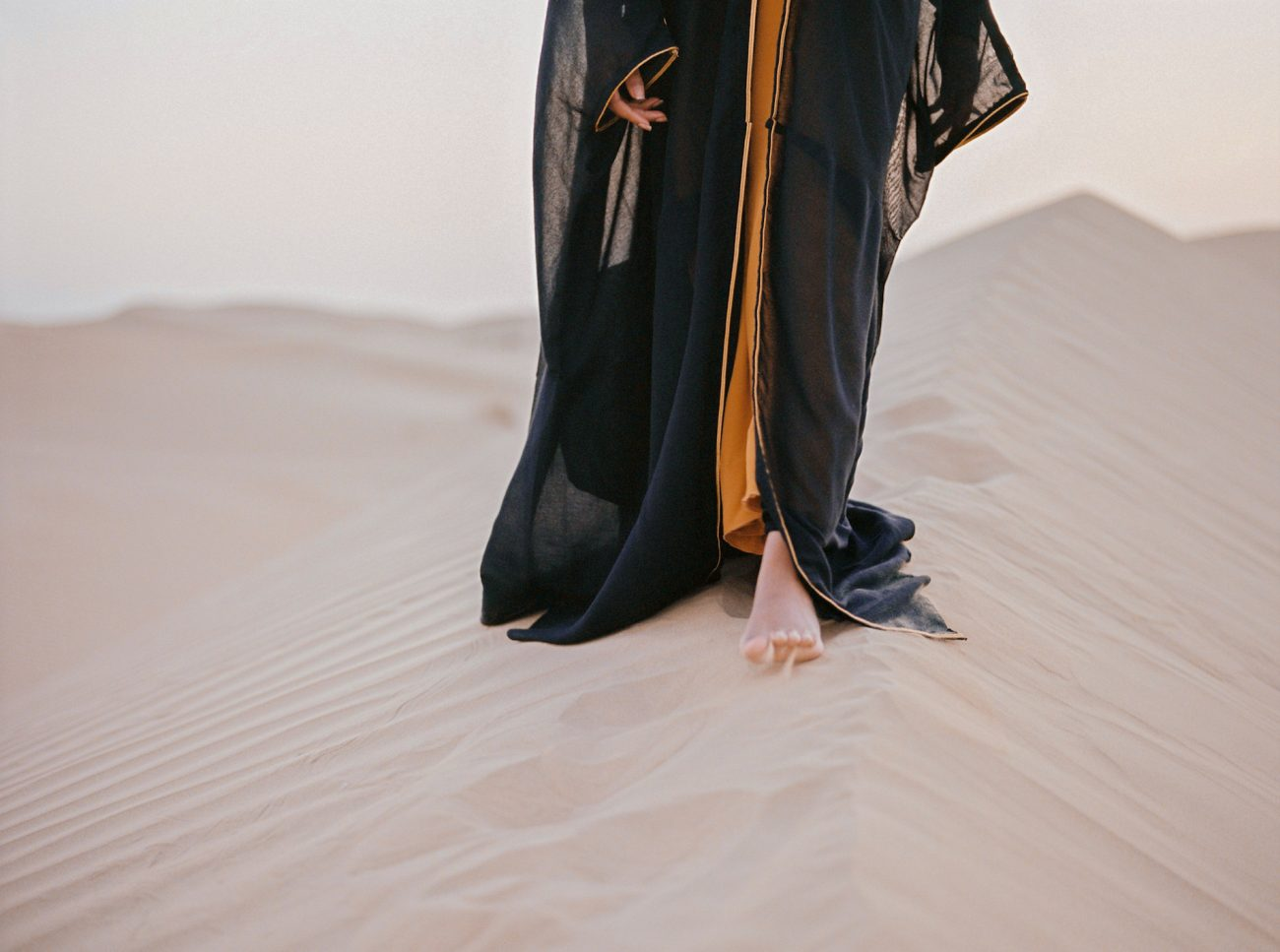 Desert fine art wedding inspiration black robe