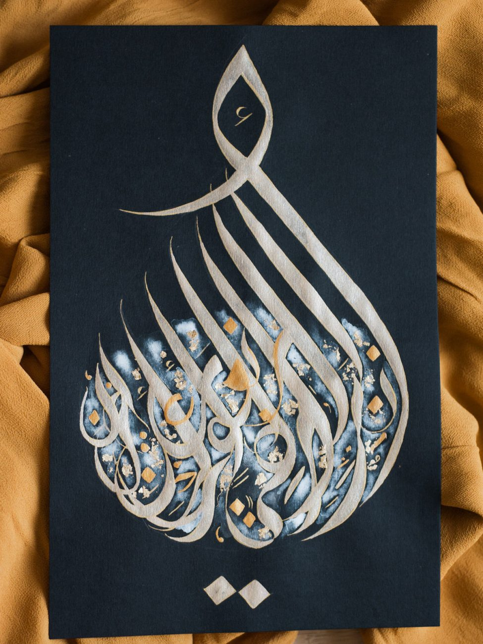 Desert fine art wedding inspiration gold Arabic calligraphy with white watercolour