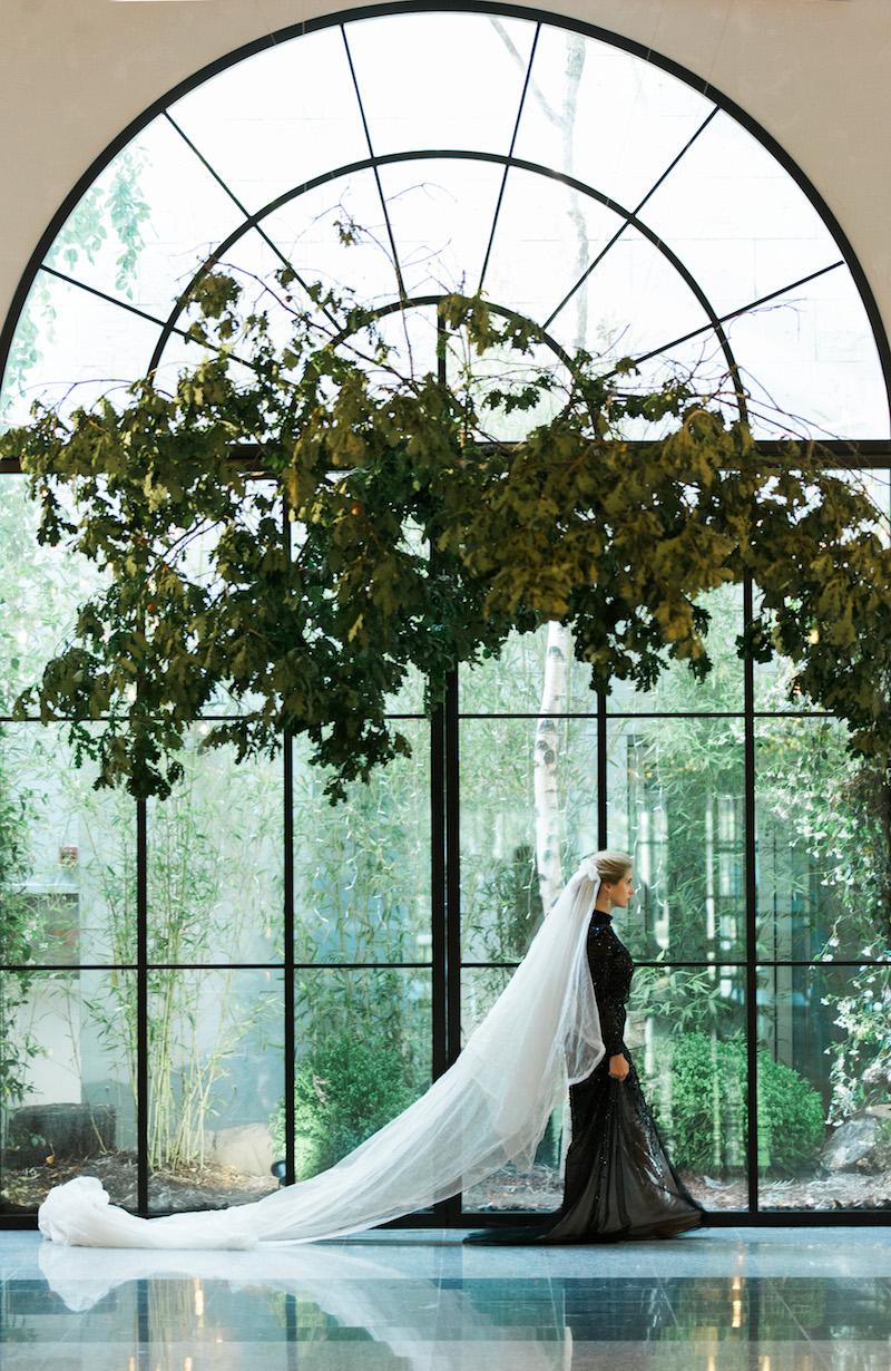 Black Tie Wedding Invitations bride with long white veil under installation