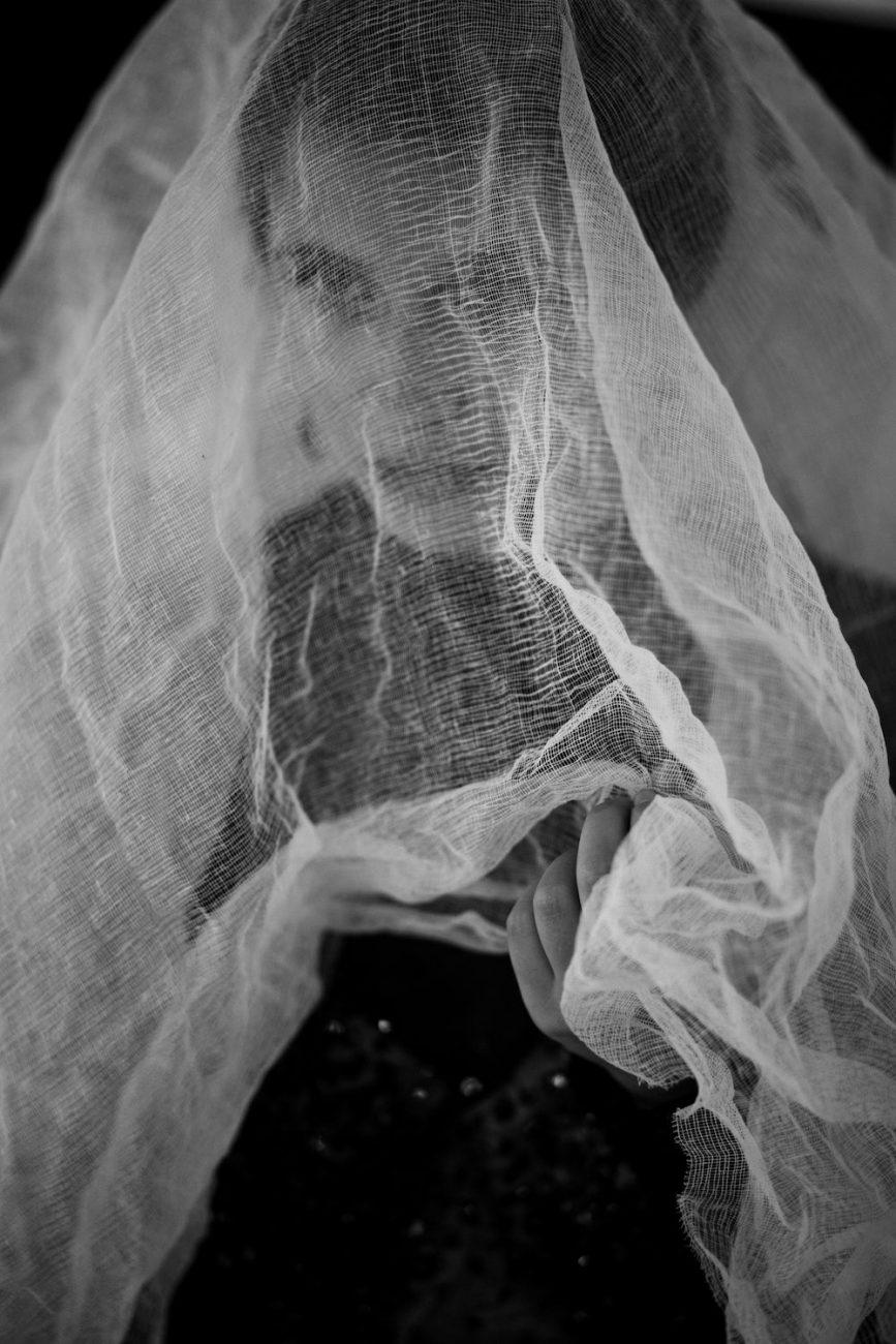 Black Tie Wedding Invitations bride with soft organic veil and a black dress