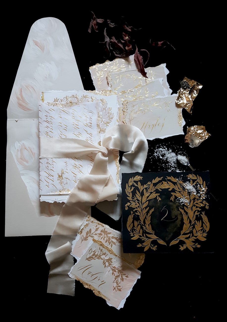 Custom Gold Foil Invitations - with gold calligraphy wrap and black table number with gold painted leaves