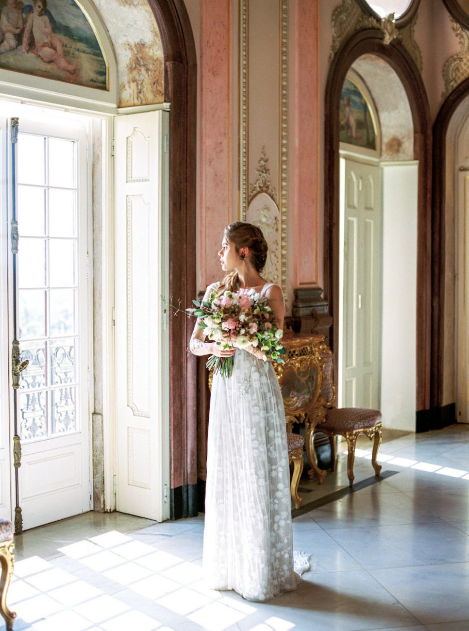Palace Wedding Inspiration bride inside palace with flowers