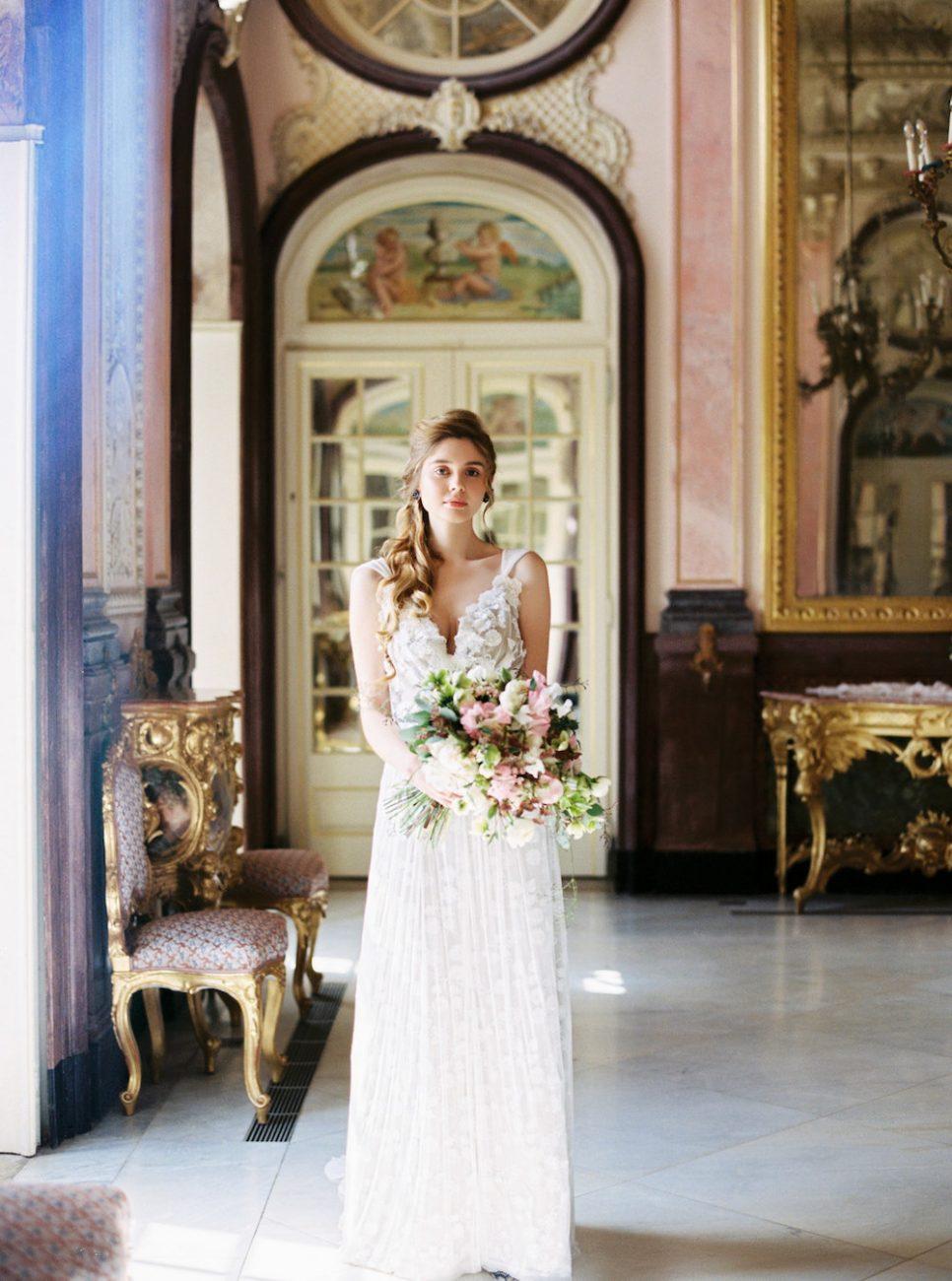 Palace Wedding Inspiration bride next to window
