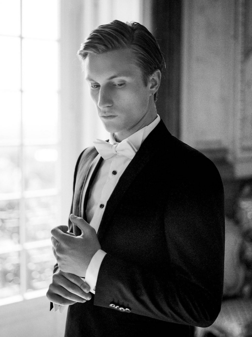 Palace Wedding Inspiration groom in black and white
