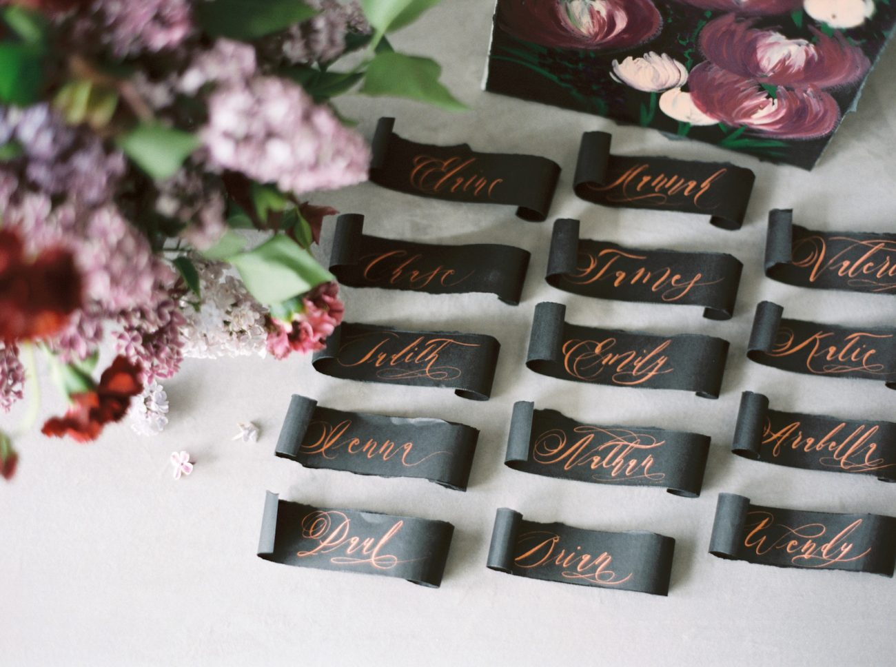 Moody Black Wedding Inspiration escort table art and place names