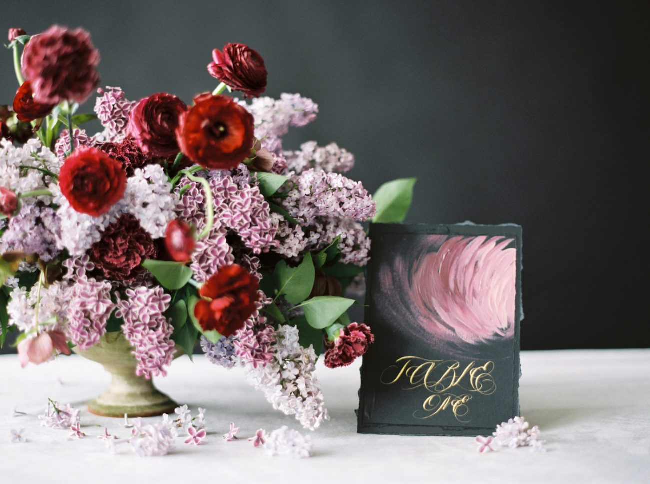 Moody Black Wedding Inspiration table number with flowers