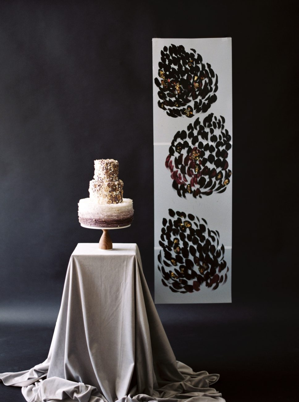 Moody Black Wedding Inspiration_ cake with hand painted backdrop behind