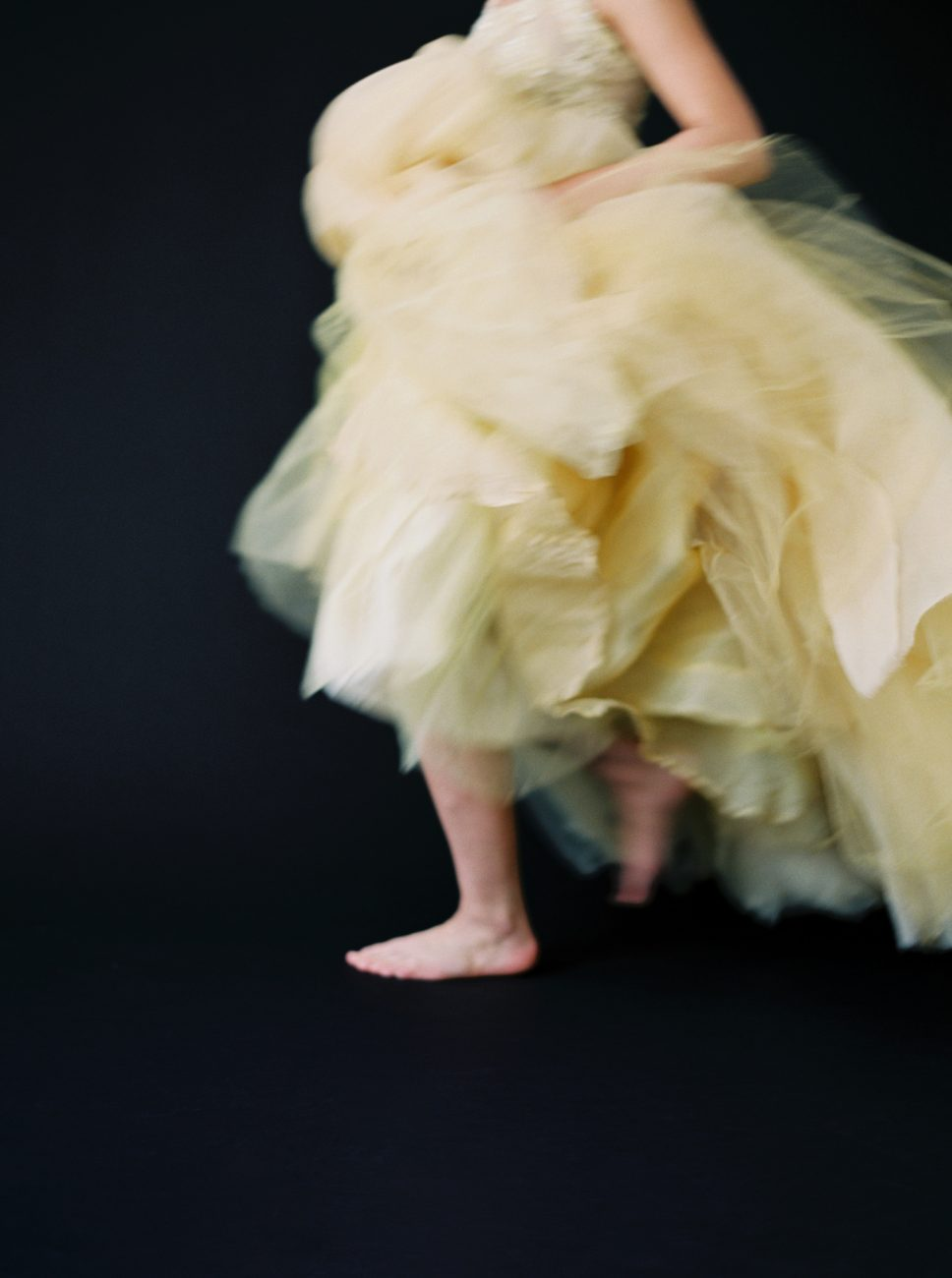 Moody Black Wedding Inspiration_bride running in yellow dress