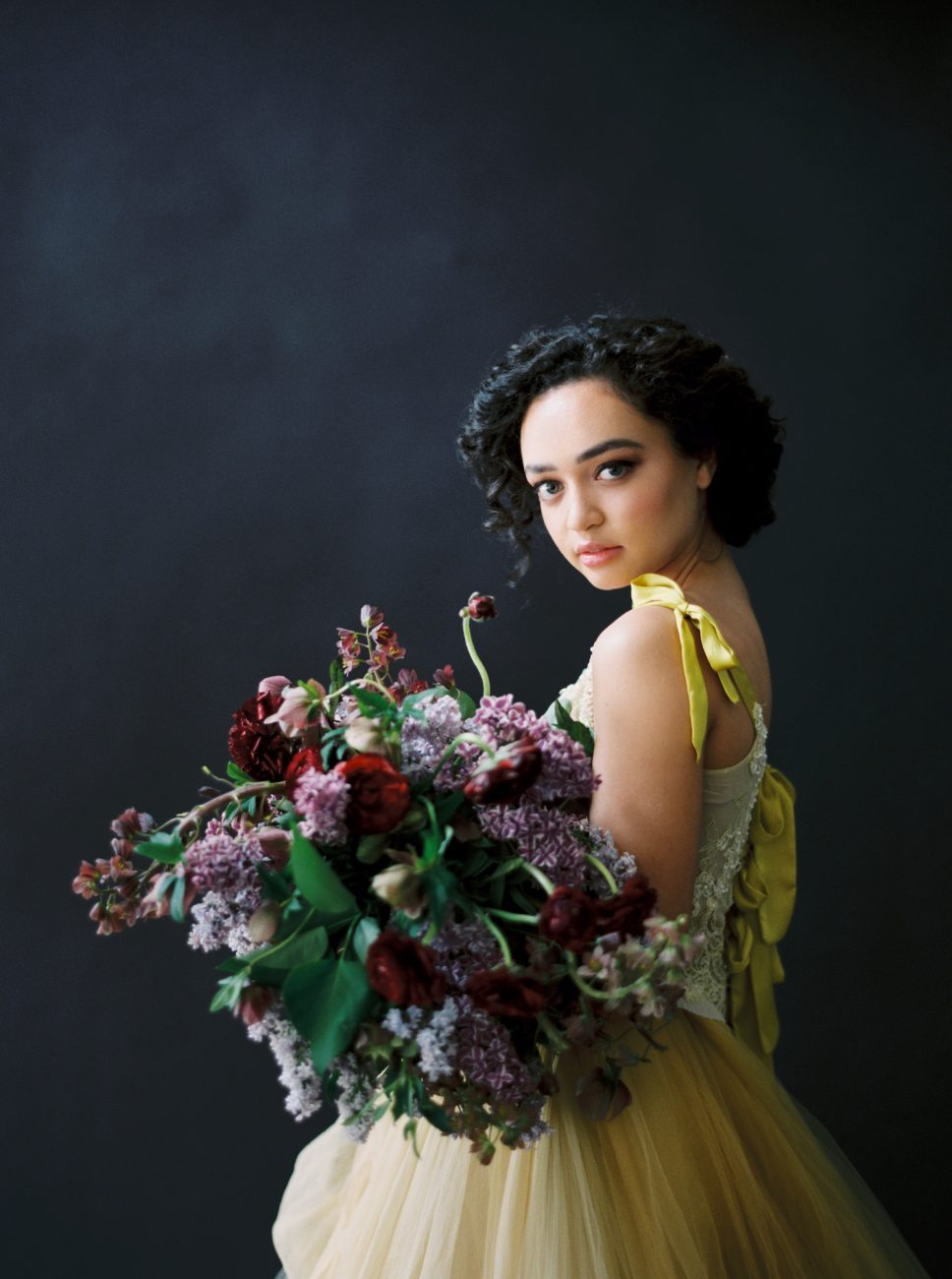 Moody Black Wedding Inspiration_model with red and lilac bouquet