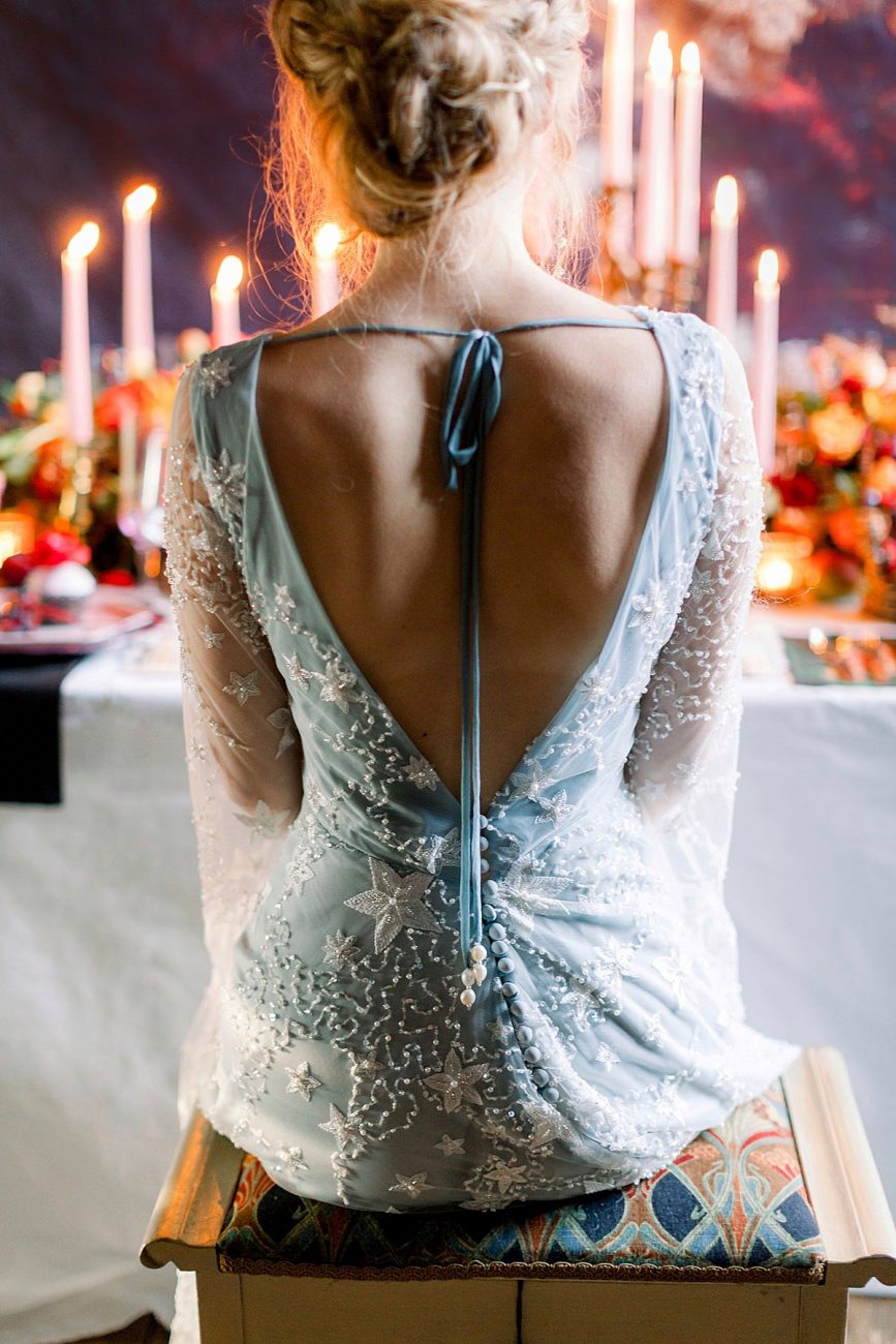 Baroque wedding with a bride in a low cut white dress with stars and beading