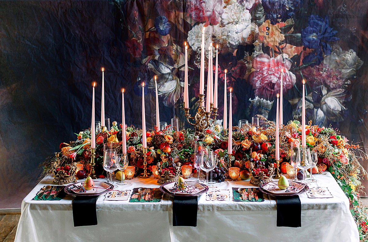 Baroque Wedding table setting ideas with dark floral backdrop