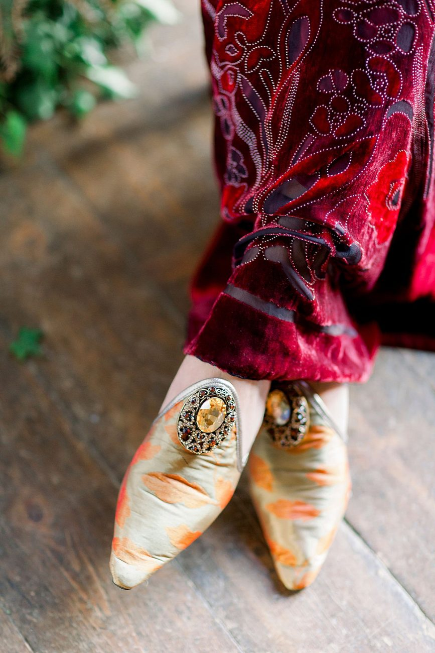 Baroque Wedding with red velvet wedding dress and gold ornate shoes