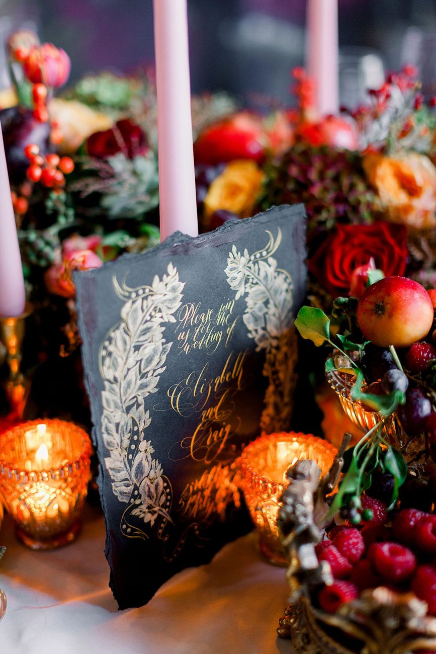 Baroque wedding inspiration with black wedding invite styled next to candles