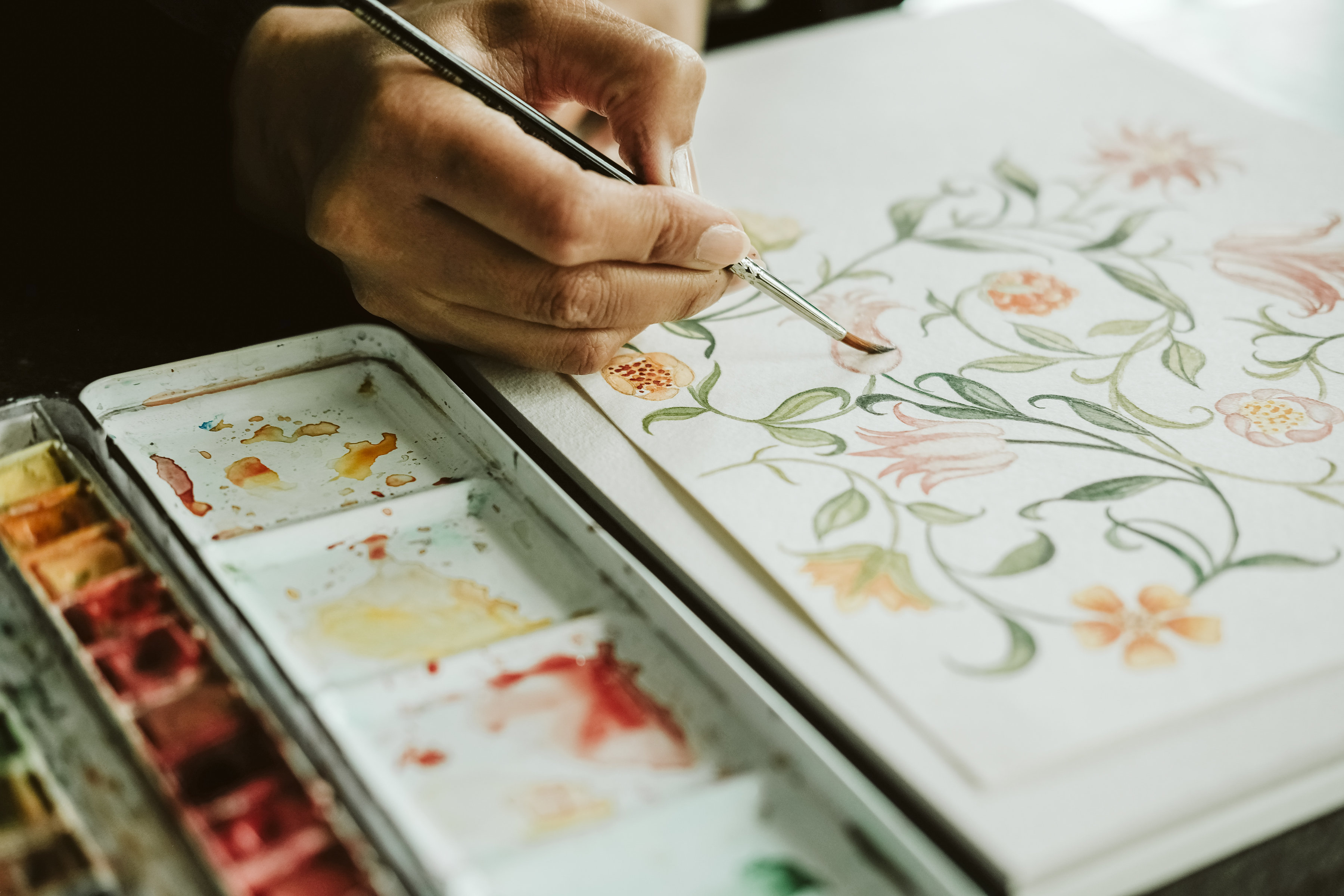 Illustrated Wedding Invitations with a floral watercolour being illustrated