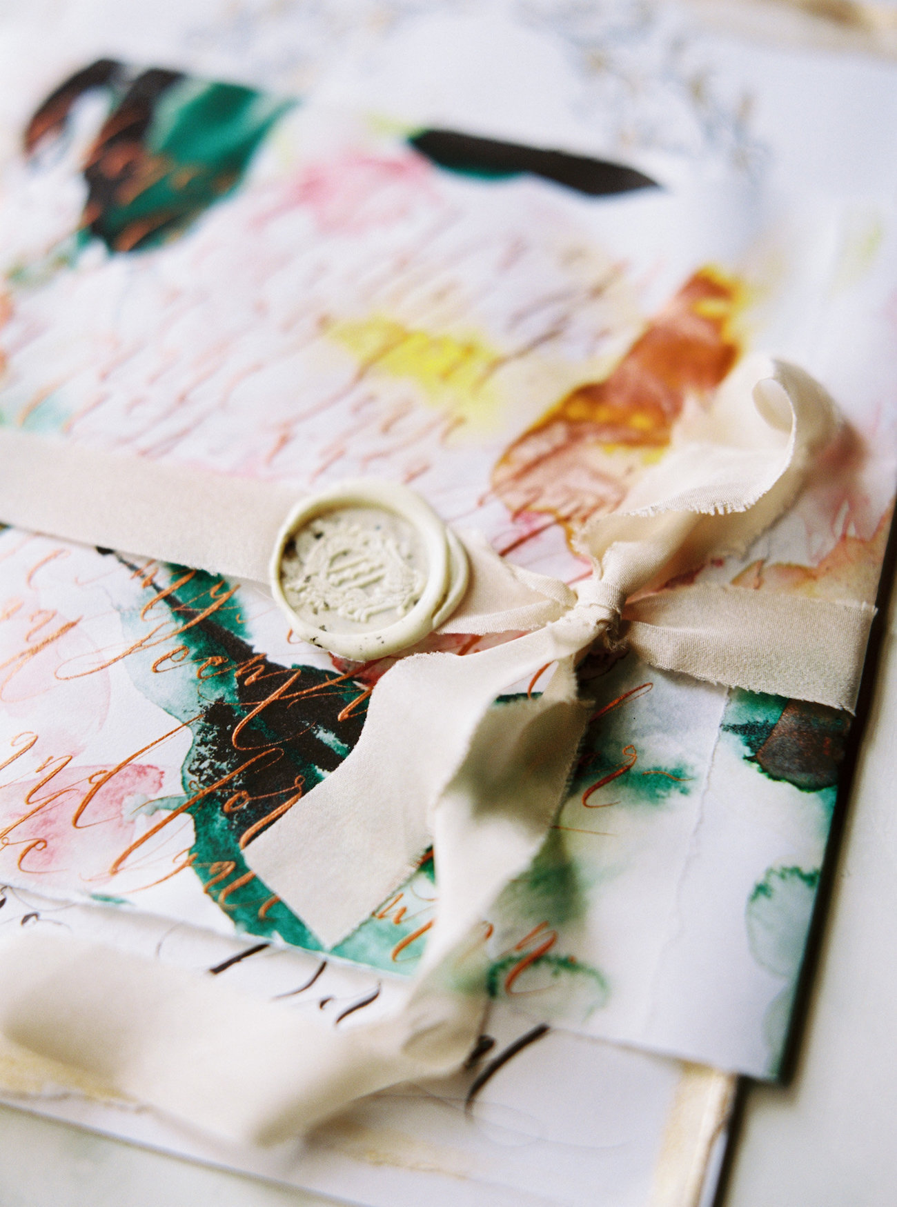 Illustrated wedding invitations with an Invitation wrap with calligraphy and watercolour