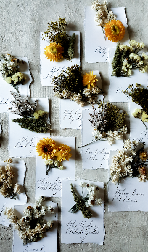 Handmade escort cards with dried flowers
