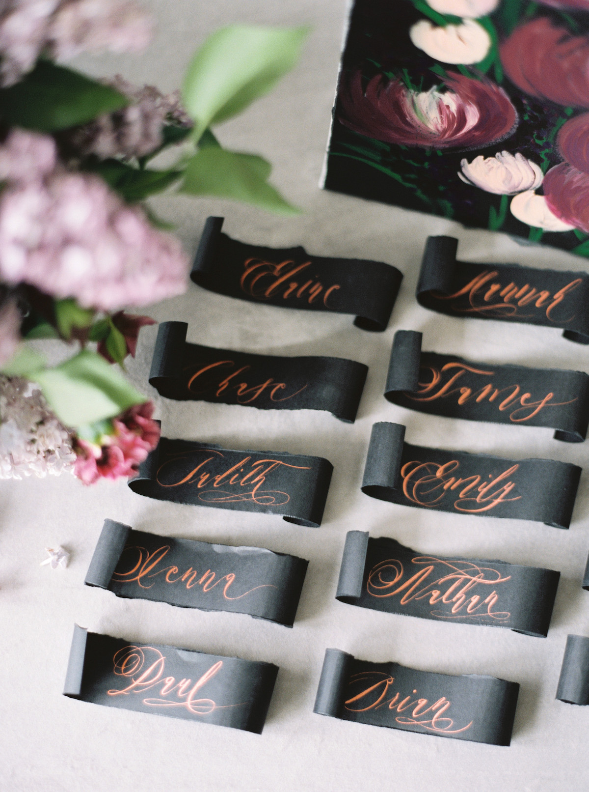 Moody black escort cards and place names