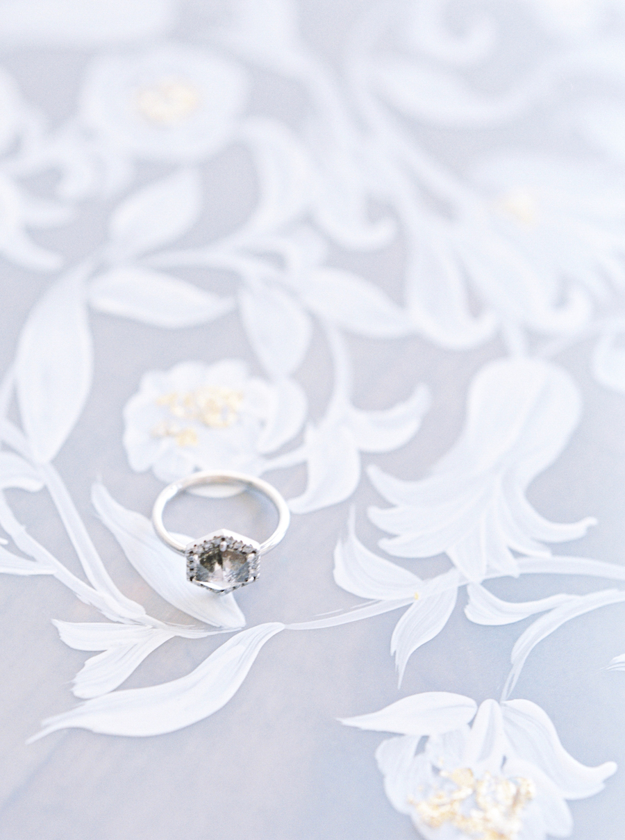 White vellum with white hand painted designs