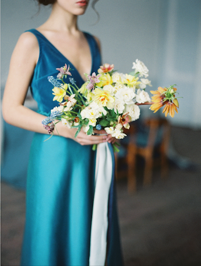 Fine Art Wedding Inspiration head shot of bride holding bouquet side view
