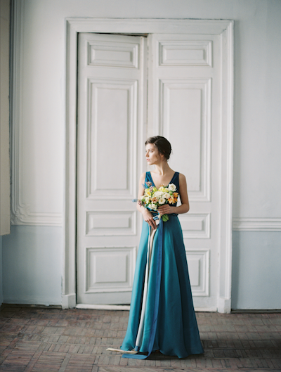 Fine Art Wedding Inspiration bride wearing blue wedding dress and holding bouquet
