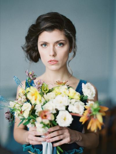 Fine Art Wedding Inspiration head shot of bride holding bouquet