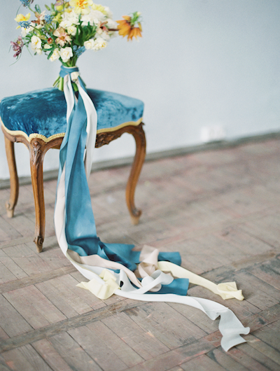 Fine Art Wedding Inspiration wedding bouquet on stool with ribbons styled on the floor