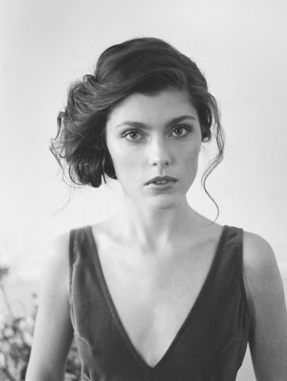 Fine Art Wedding Inspiration with black and white view of the bride with hair in an up do