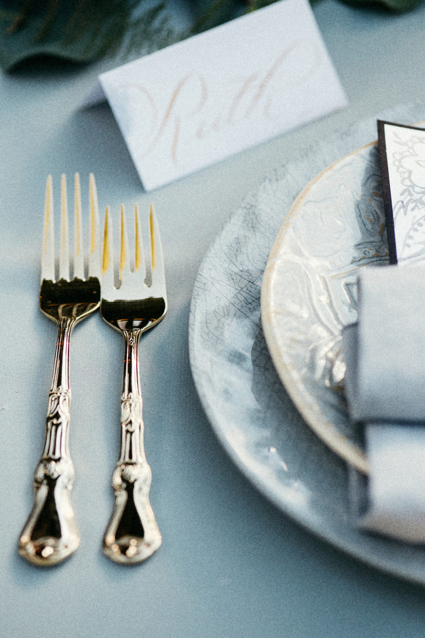 Style Shoot in Tuscany, Italy bridal table setting with forks and place name card