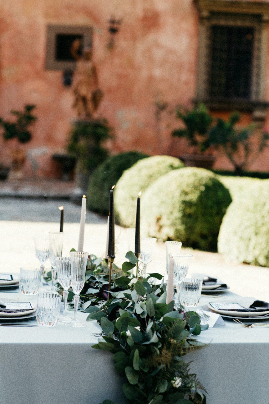 Style Shoot in Tuscany, Italy bridal table with glasses and candles