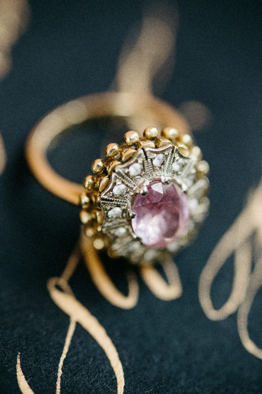 Style Shoot in Tuscany, Italy gold calligraphy close up with ring