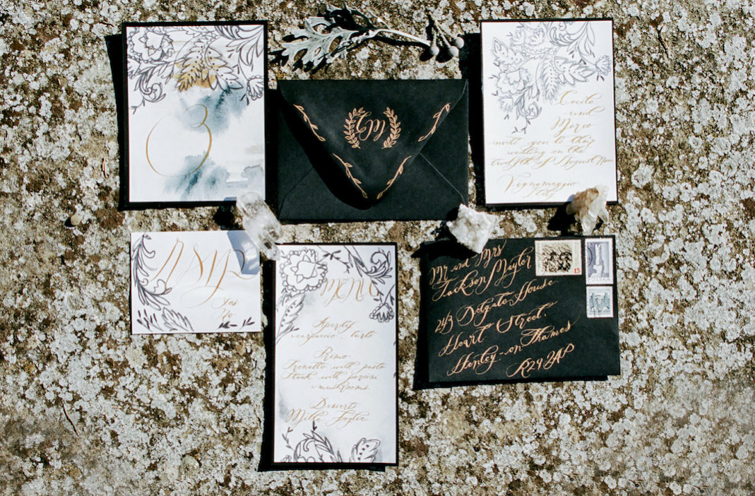 Style Shoot in Tuscany, Italy hand painted wedding stationery with black white and gold.