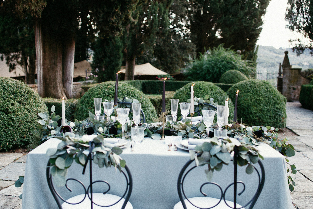 Style Shoot in Tuscany, Italy wedding table decoration ideas with black candles and glasses