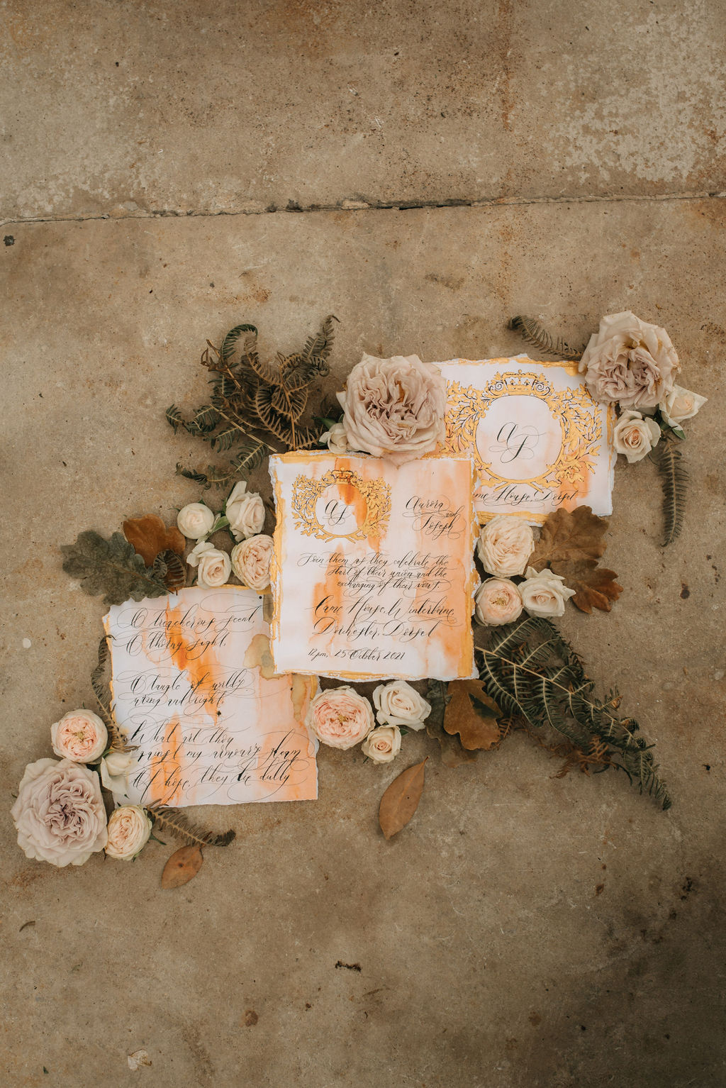 Watercolour invitation background with beautiful coral accents with gold hand painted details