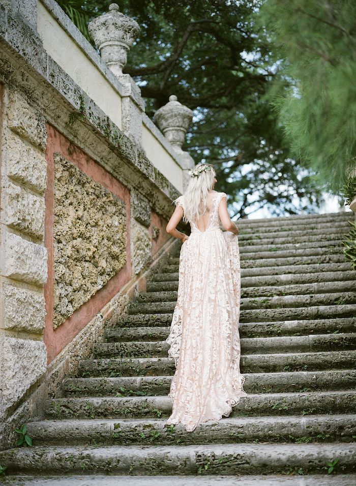 Vizcaya Wedding Inspiration bride holding dress up as she walks up steps at Vizcaya