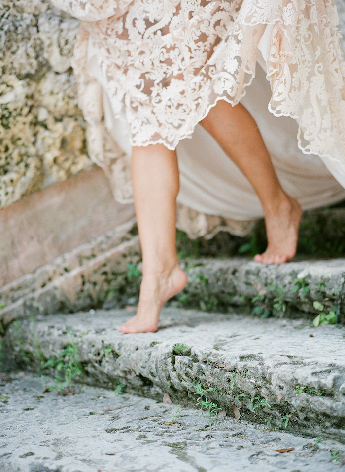 Vizcaya Wedding Inspiration bride walking down steps showing dress lifted up