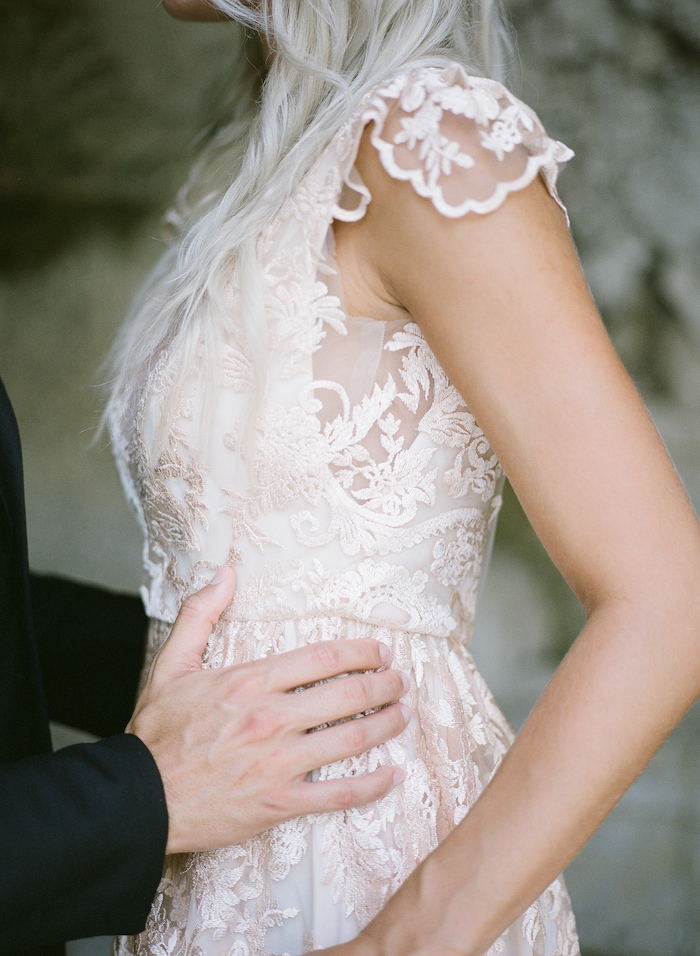 Vizcaya Wedding Inspiration close up of bride's dress with blush lace design