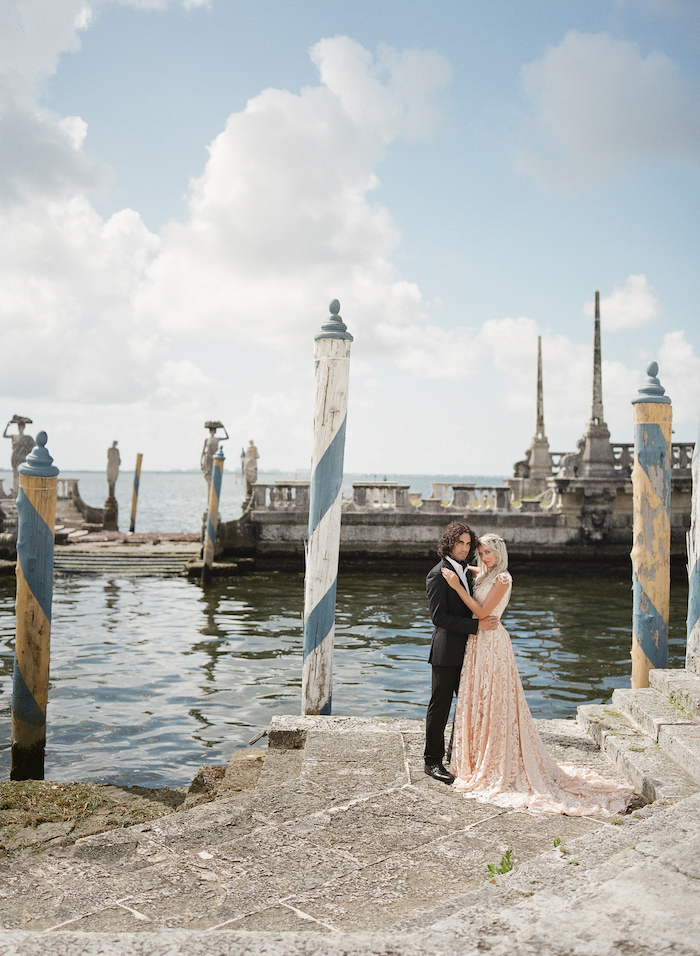 Vizcaya Wedding Inspiration couple by waterfront and steps