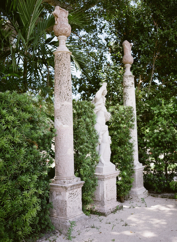 Vizcaya Wedding Inspiration green bushes next to columns and statue