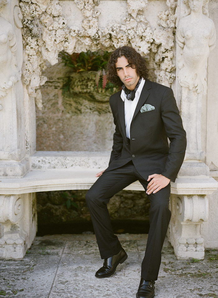 Vizcaya Wedding Inspiration groom sitting on stone bench