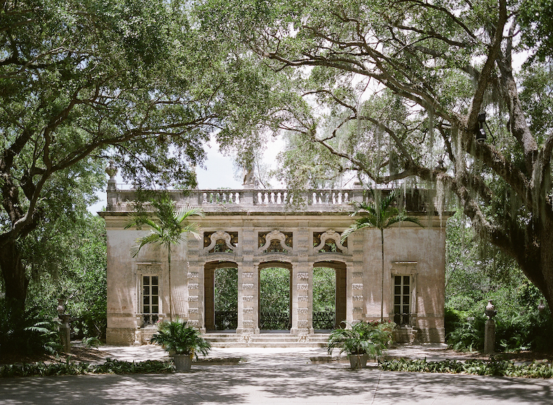 Vizcaya Wedding Inspiration with an architectural classical building amongst the tress in Vizcaya gardens