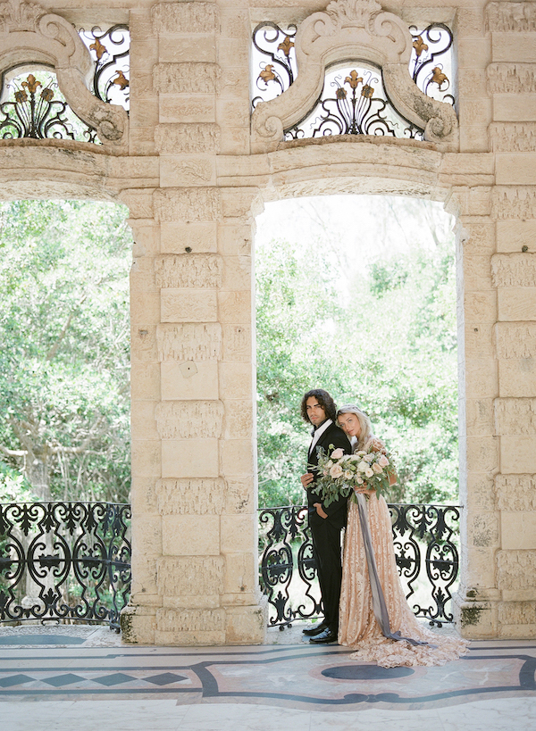 Vizcaya Wedding Inspiration with bride and grrom within an architectural building in Viczaya