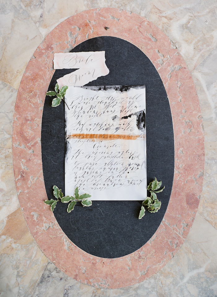 Vizcaya Wedding Inspiration with fine art calligraphy photographed on a marble tiled floor