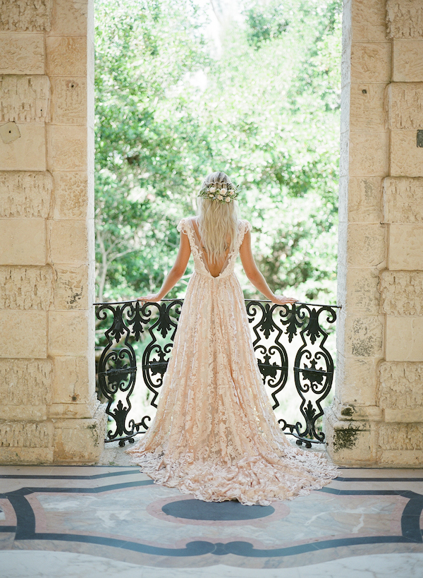 Vizcaya Wedding Inspiration with the bride looking out from the terrace in Vizcaya Gardens