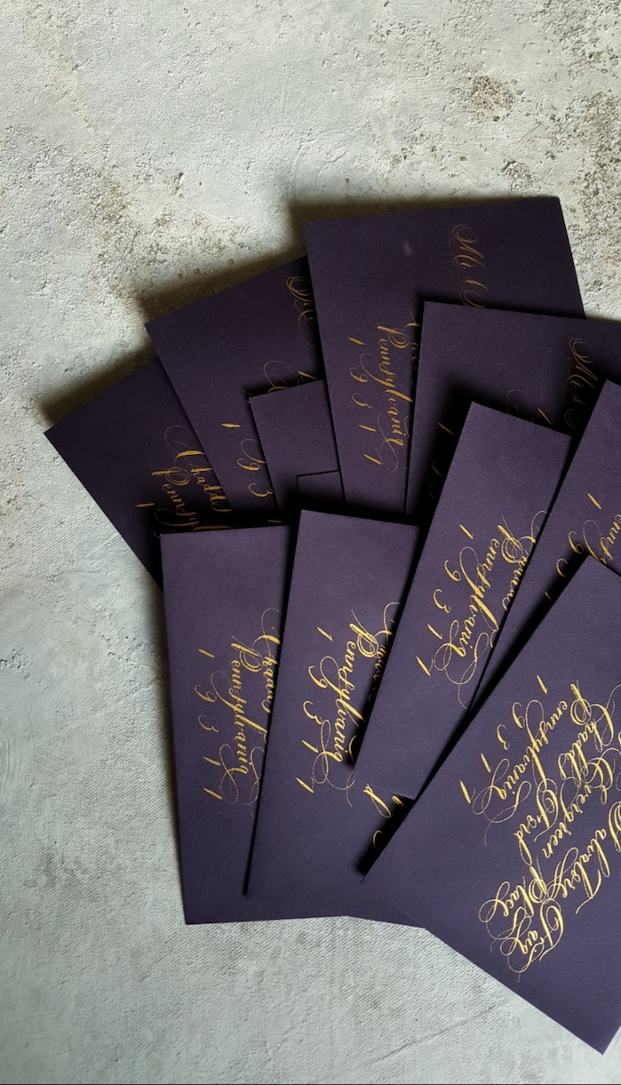 Custom Hand Painted Invitations Featuring Purple Envelopes with Gold Calligraphy